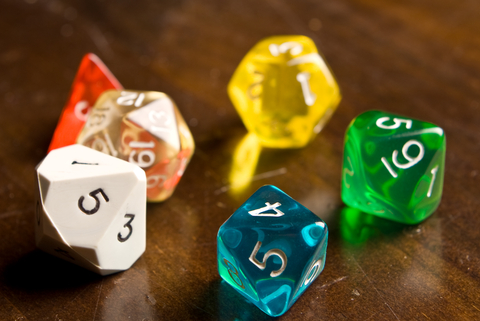 http://www.dreamstime.com/stock-photo-multi-colored-role-play-dice-sitting-wooden-table-top-taken-low-angle-side-lighting-depth-field-used-to-add-drama-to-photo-image29922640