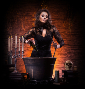 http://www.dreamstime.com/royalty-free-stock-photos-sexy-brunette-witch-making-poison-young-caucasian-dark-clothes-large-pot-image-taken-dark-foggy-image33453138